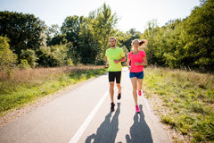 Couple running together Royalty Free Stock Image