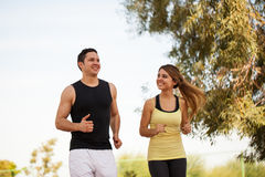 Couple running together and having fun Royalty Free Stock Photography