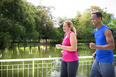Couple running together in the park Royalty Free Stock Photography