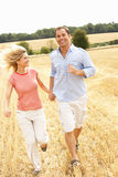 Couple Running Together Through Summer Harvested F Stock Images