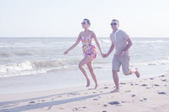 Couple running together Stock Photo