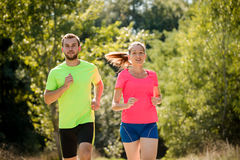 Couple running together Royalty Free Stock Images