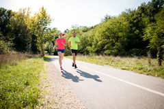 Couple running together Royalty Free Stock Photography