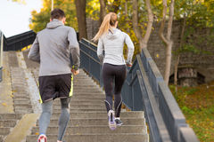 Couple running upstairs in city park Stock Photography
