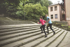 A couple running upstairs in a park Royalty Free Stock Photo