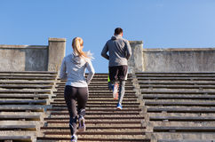 Couple running upstairs on stadium Royalty Free Stock Photos