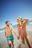 Couple running in water Royalty Free Stock Image