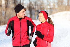 Couple running in winter royalty free stock photography