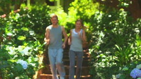 Couple running in a wood stock footage