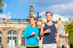 Couple running at Zwinger , Dresden Stock Image