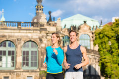 Couple running at Zwinger in Dresden stock photography