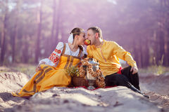 Couple in russian national dress royalty free stock photography