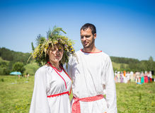Couple in russian traditional dress on the meadow Stock Image