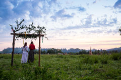 Couple in russian traditional dress on the meadow Stock Images