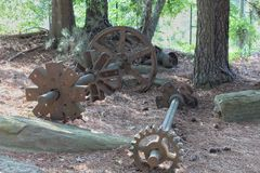 A couple of rusted gears and shafts stock image