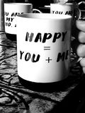 Couple's coffee cup. You and me happy. Lovely text on a coffee cup royalty free stock image