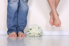 The couples feet. With a bouquet Stock Photography