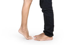 The couple's feet. Young couple in love and kissing concept Royalty Free Stock Photo