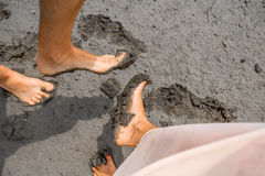 Couple's feet in the mud Royalty Free Stock Images