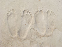 Couple's footprints in the sand Stock Photo
