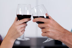 Couple's hands holding glasses of wine Royalty Free Stock Photos