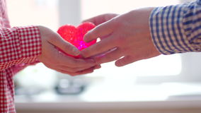 Couple`s hands holding together symbol of love Heart stock video footage
