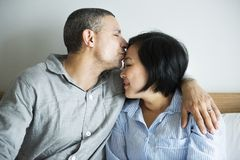 A couple`s intimate moment in bedroom Stock Photo