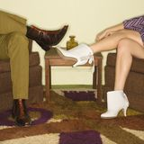 Couple's legs in boots. stock images