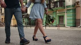 Couple`s legs walking down the city street stock video