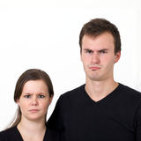 Couple's Serious Expressions Stock Image