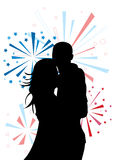 Couple's silhouette on firework background Stock Photography