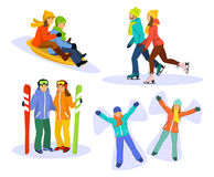 Couple's snow and ice fun winter activities: sledding, ice skating, skiing and lying on snow and laughing Royalty Free Stock Photography