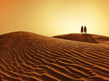 Couple in sahara desert royalty free stock photos