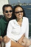 Couple on sailboat Stock Image