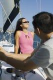 Couple on sailboat Stock Photo