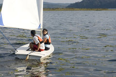 Couple Sailing Across Lake - Horizontal Royalty Free Stock Photo