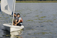 Couple Sailing Across Lake - Horizontal Royalty Free Stock Photos
