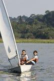 Couple Sailing Across Lake - Vertical Stock Photos