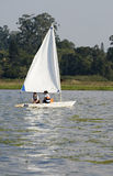 Couple Sailing Across Lake - Vertical Royalty Free Stock Image