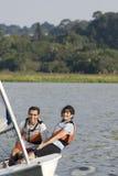 Couple Sailing Across Lake - Vertical Royalty Free Stock Photo