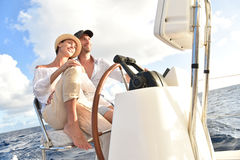 Couple sailing in caribbean sea Stock Photography