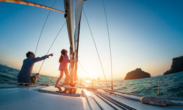 Couple. Sailing in the tropical sea Royalty Free Stock Photo