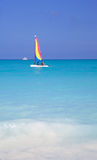 Couple Sailing Turquoise Waters. A happy couple sails the turquoise waters of the Bahamas stock image
