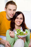 Couple with salad Stock Photos