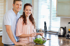 Couple with salad in the kitchen Stock Image