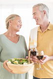 Couple With Salad And Red Wine At Home Royalty Free Stock Photography