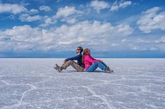 Couple at Salar de Uyuni , Bolivia Stock Photos