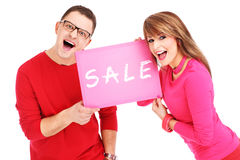 Couple with sale board Stock Image