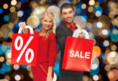 Couple with sale and discount sign on shopping bag royalty free stock photo