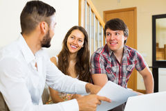 Couple and salesman talking Stock Photography